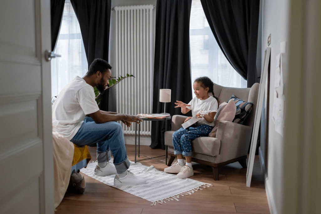 Child communicating and laughing with parent